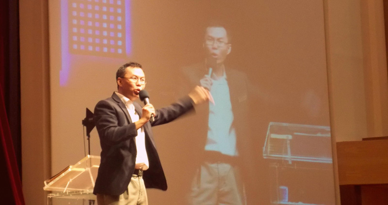 Executive Pastor Victor Wong, preaching fervently about the topic of boasting