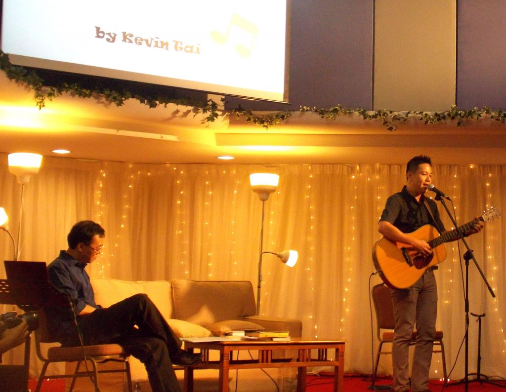 Caption - Kevin Tai from TNCC, during his performance including the leading of Praise and Worship
