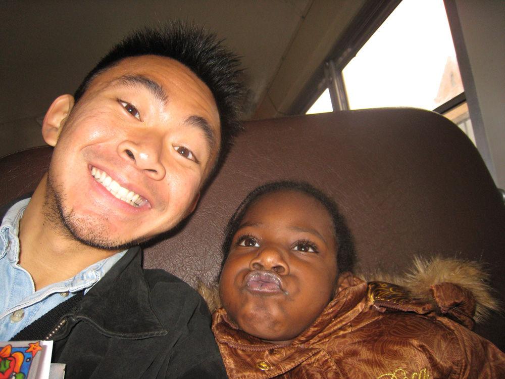 Timothy clowning with kid