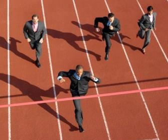 Businessman Winning Race --- Image by © Royalty-Free/Corbis