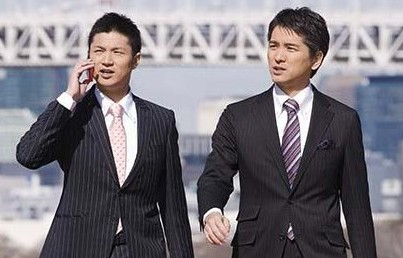 Asian businessmen walking outdoors