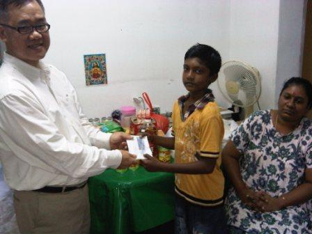 Bro Joshua giving to the needy