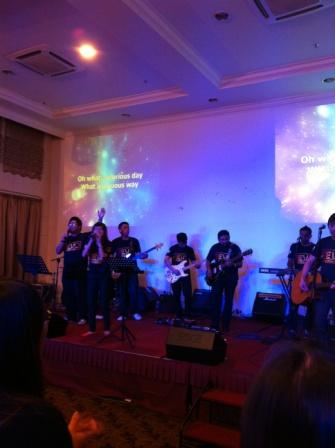 The Revo Band leading students into a time of worship