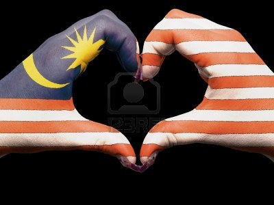 13038827-tourist-made-gesture-by-malaysia-flag-colored-hands-showing-symbol-of-heart-and-love