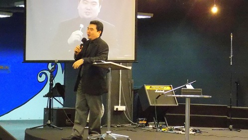Rev Kenneth Chin preaching the Word of the day