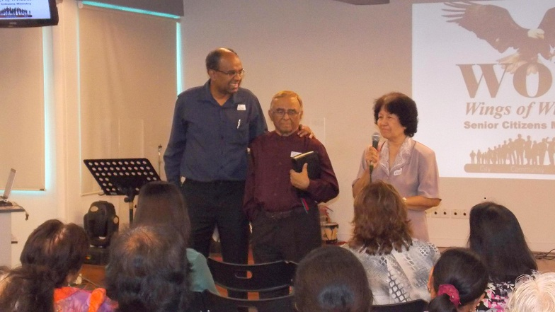 Senior Pastor Suresh of City Revival introducing Pastor Louis Manuel and his wife