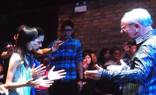 Rev Mike Connell praying for Senior Pastor Kevin Loo and his wife as they marked their 8th anniversary together