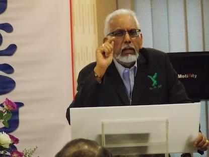 Rev Jai Kumar accentuating a point