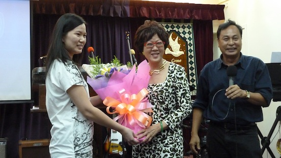 Dr Peggy Wong presented with flowers