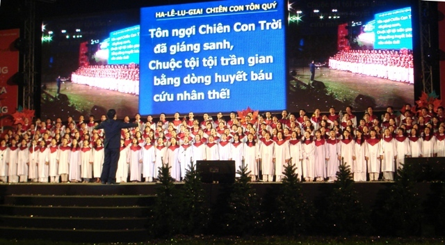 Tony directing the Christmas choir in the stadium in Saigon, 2007