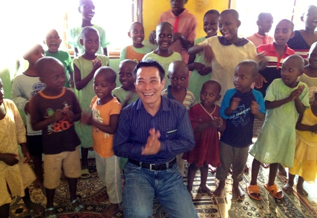 Tony with Ugandan orphans in Africa, 2013