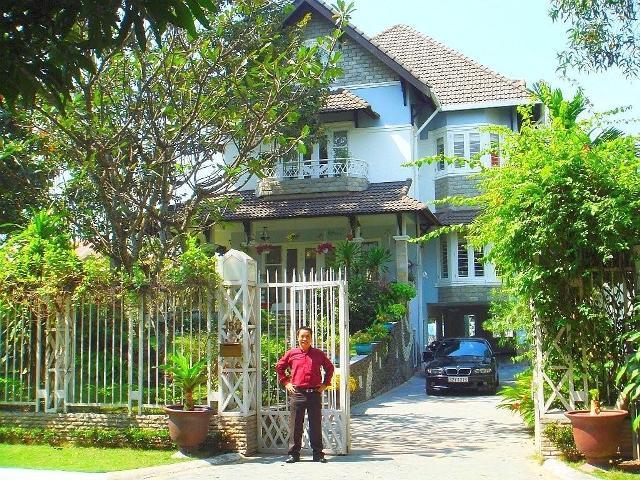 Tony with his villa and car