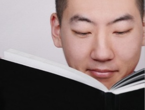 young_asian_man_reading_a_book_poster-rfae6f87256684b84801bb4a44929302e_wv3_8byvr_324