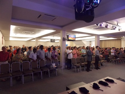 The congregation worshiping God