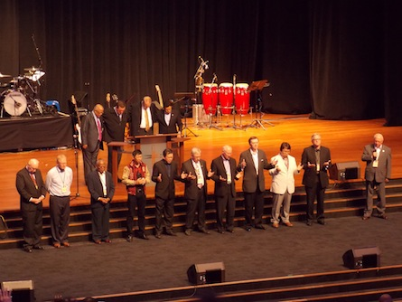 Executive members of the PWC 2013 Committee praying with the attendees