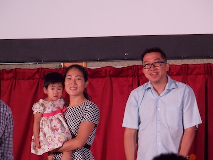 Joshua Hoh Si Peng with his wife and child