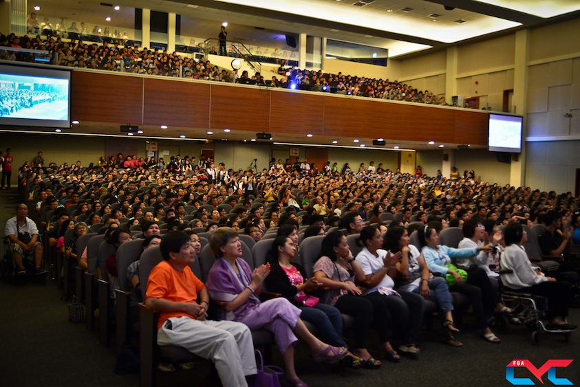 The auditorium packed with people