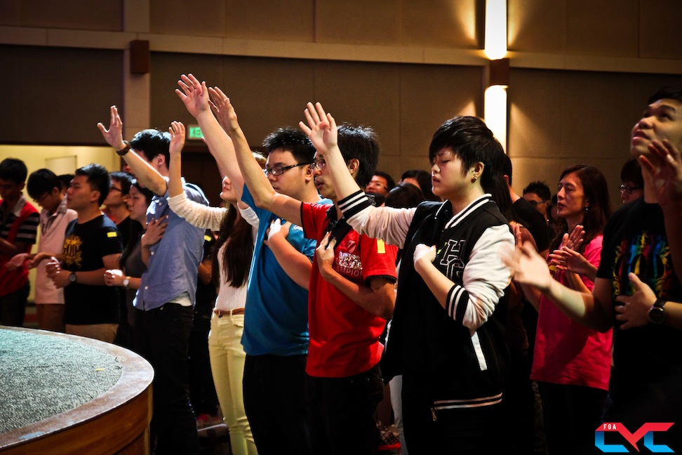 Youths lifting their hands in worship