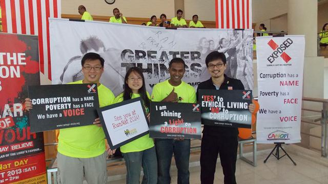 A team of people including Victor Chua (Founder of RunNat-far right) supporting EXPOSED