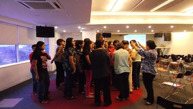 Pastor Tryphena praying for the ladies