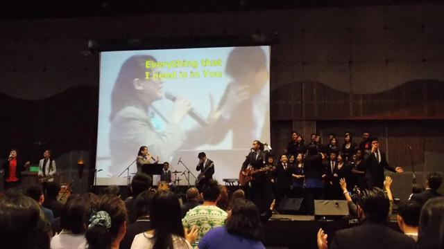 Pr Sandra Chin heading the praise and worship