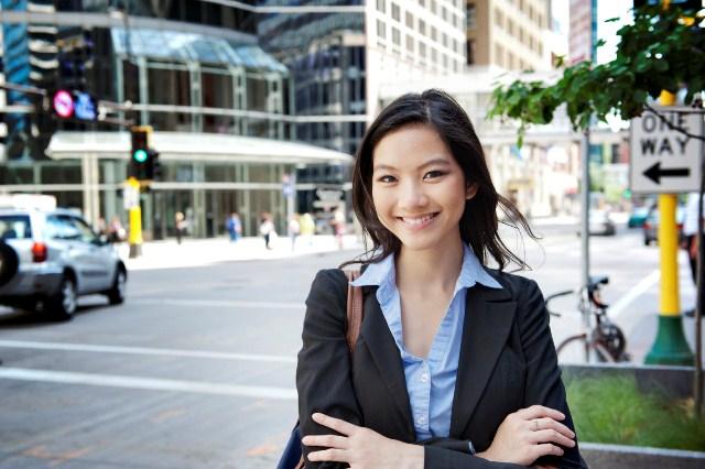 Businesswoman Standing On City Street