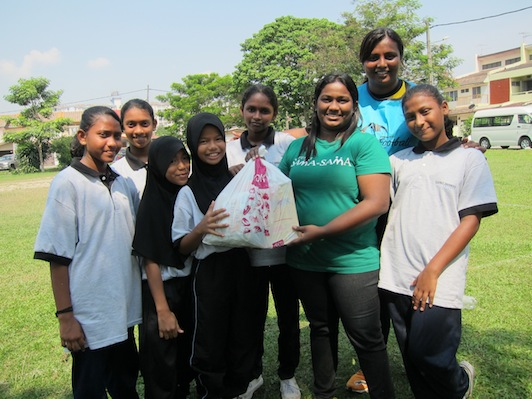 Rachel Shanti (second from right) with the children of her sports program