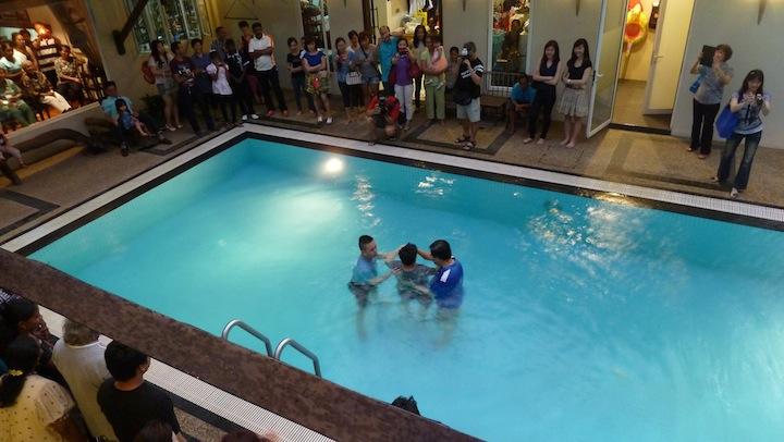 Baptism in the swimming pool
