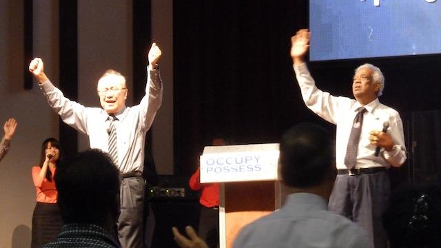 Datuk Paul Low and Rev Henry Pillai worshiping God