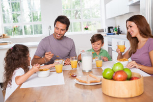 bigstock-Family-eating-healthy-breakfas-42576541
