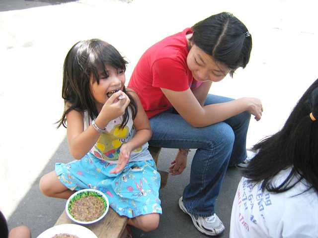 Rachel in a feeding program at a slum area in the Philippines