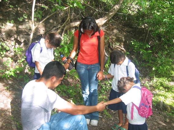 jason_and_ruth_praying_with_children