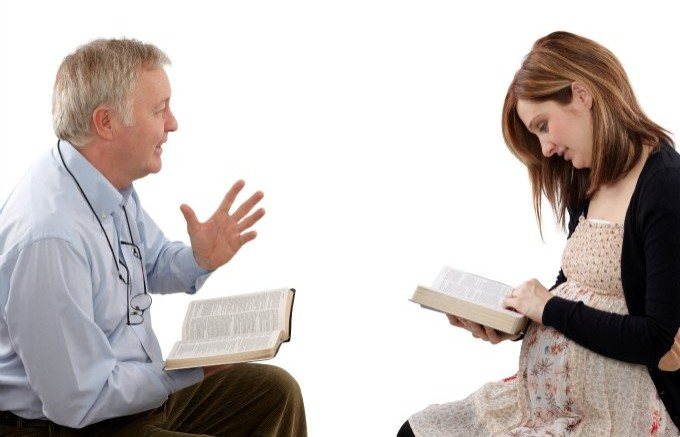 Christian father talking to his daughter from Scripture, about children