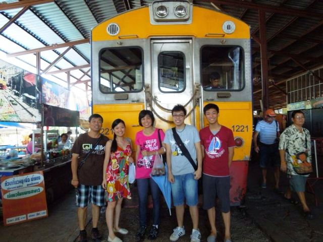 Wei Leng (middle) with her husband and family in Bangkok recently