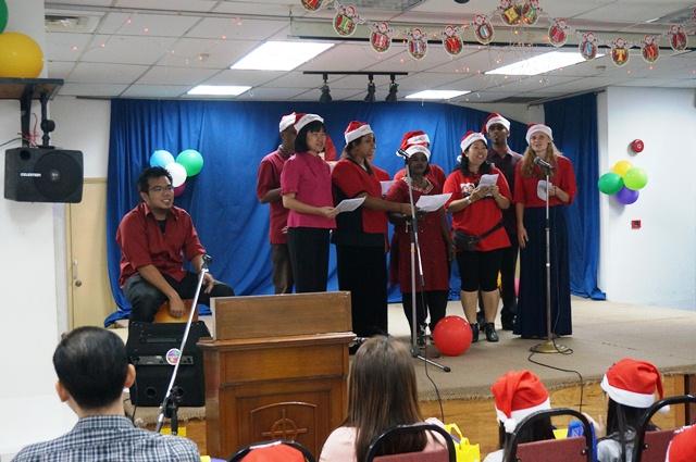 Staffs of Malaysian CARE singing Christmas carols