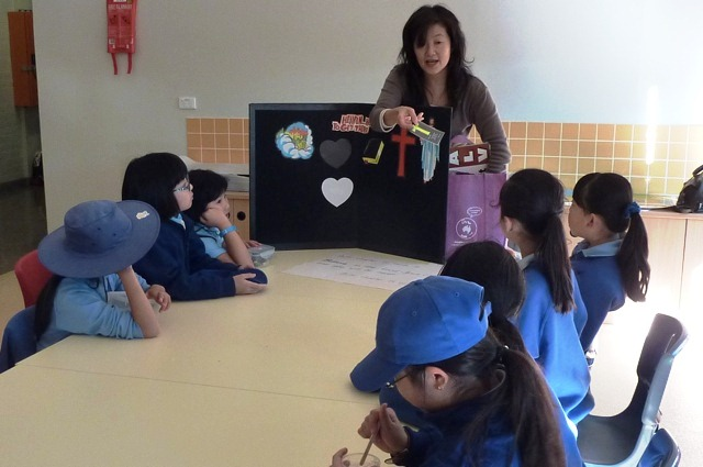 Pauline Pang teaching children during the lunch-time school club
