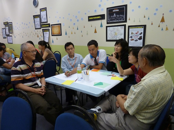 Lim Kah Hooi (most left) also sharing his work experiences with the group