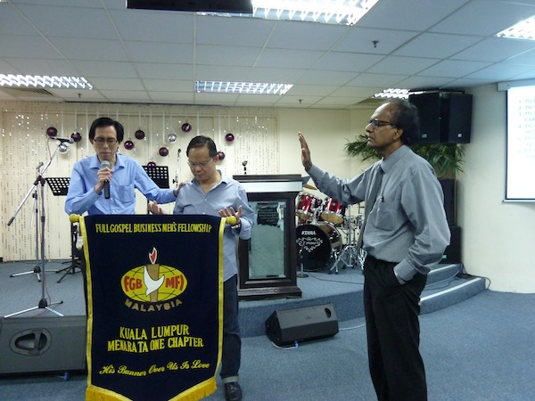 The FGB praying for Eddy Yong