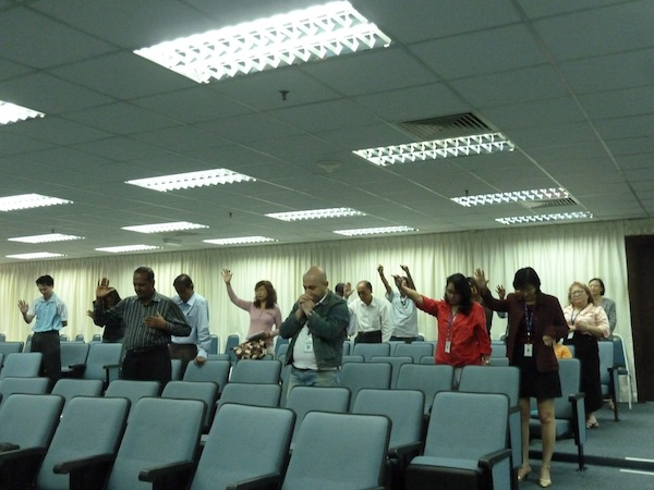 Working adults coming together during the lunch hour to worship God