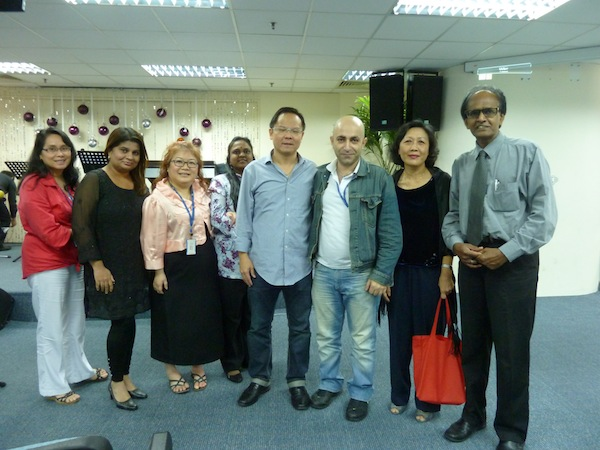 Eddy (4th from right) taking a picture with the people who came to the FGB meeting
