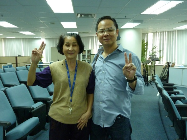 Eddy with a happy sister-in-Christ who had received healing from God after praying in the FGB meeting