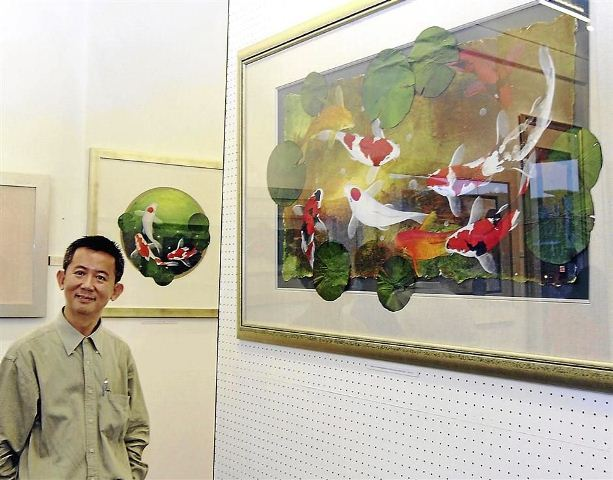 Tommy Chen with his painting