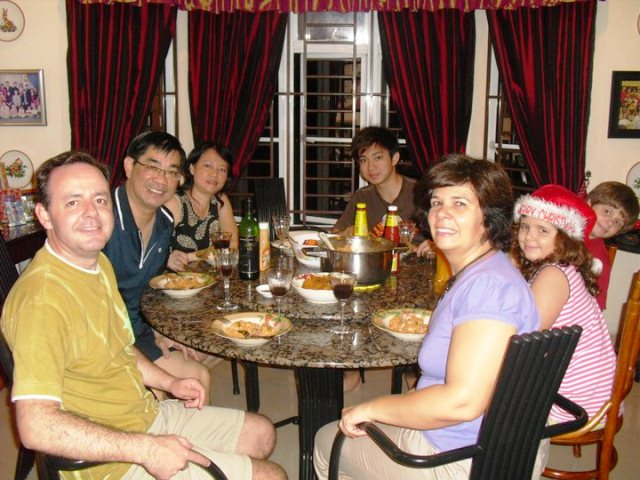 Brito and his family with Pr Wah Lok and their family having dinner together