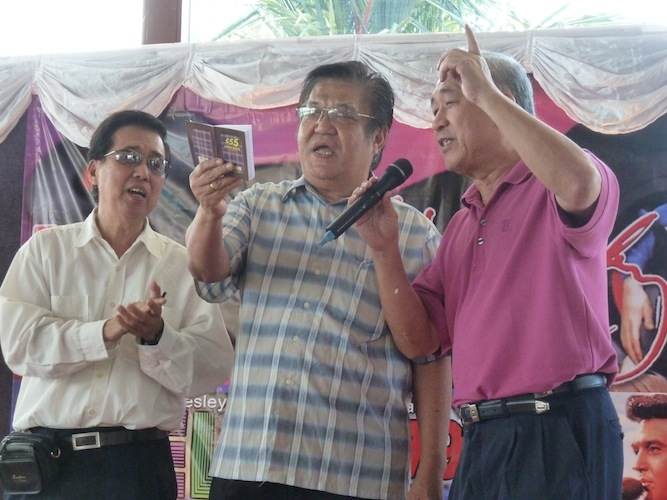 JM Tan, Max Loh, and David Lim singing Wooden Heart