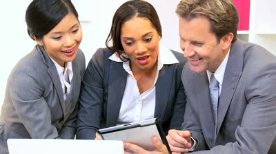 stock-footage-three-young-multi-ethnic-business-colleagues-in-close-up-using-wireless-technology-informal-meeting