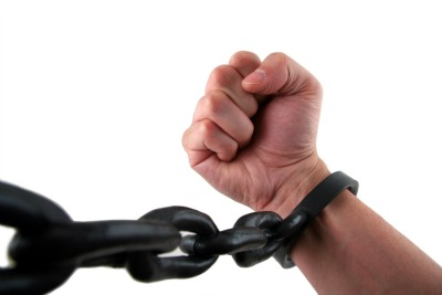 Male Hand with Fist Chained to Linked Cuffs