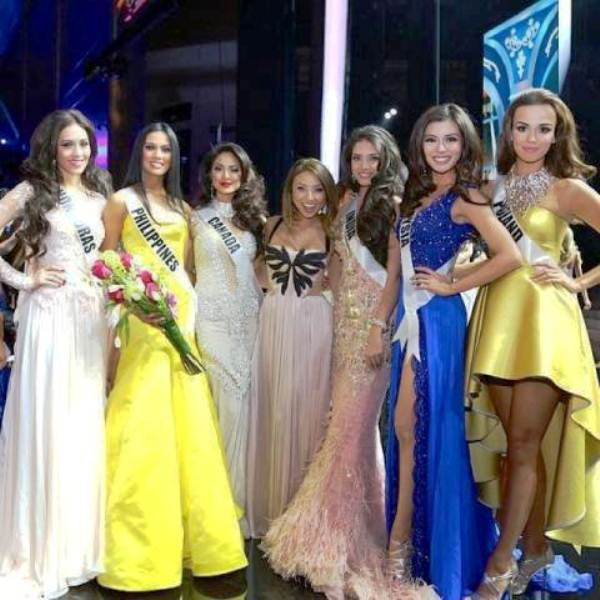 Carey Ng (2nd from right) with other candidates in the Miss Universe International