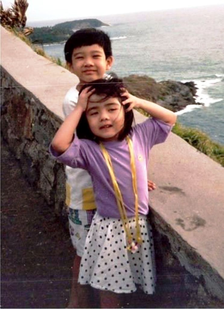 Carey Ng with her older brother, during her younger days