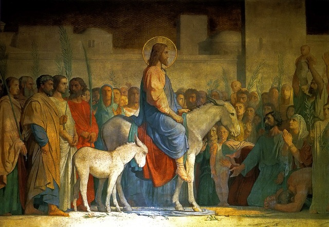 Christ entering Jerusalem on a donkey, with large crowds spreading cloaks and branches (Matthew 21)