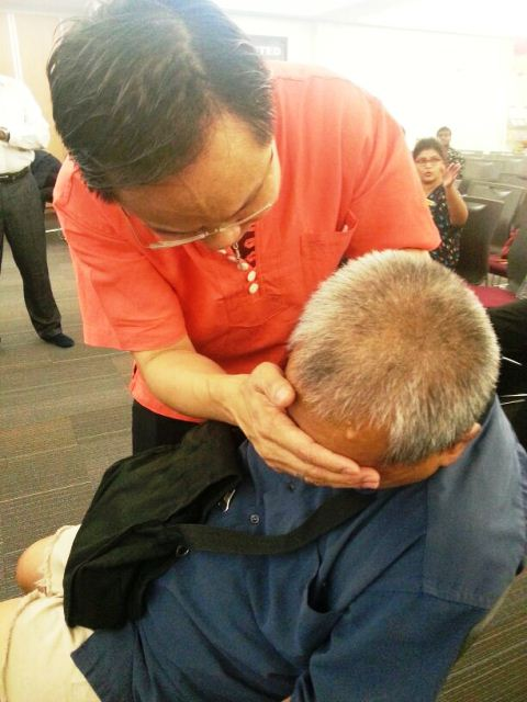 The Lord Jesus healing the blind through the laying of hands by Eddy Yong